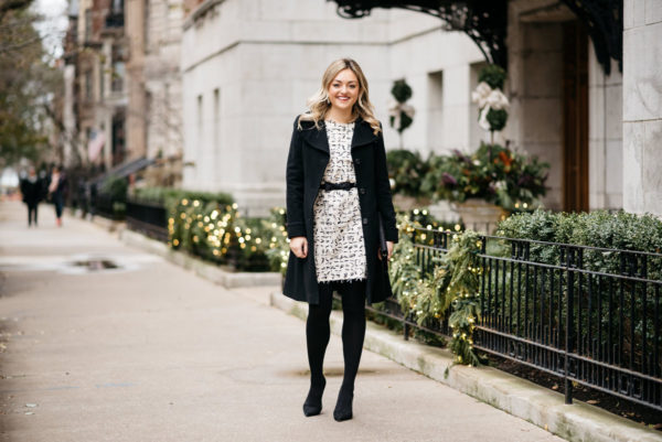 Chicago blogger Jessica Rose Sturdy wearing a Ralph Lauren black wool coat, Sail to Sable bow dress, J.Crew black tights and Kate Spade pumps with a J.Crew bow belt and a black envelope clutch.
