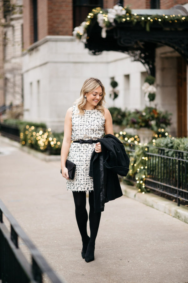 Jessica Rose Sturdy wearing a Sail to Sable bow dress, Loren Hope earrings, J.Crew tights, and Kate Spade pumps with a Ralph Lauren wool coat and an envelope clutch.
