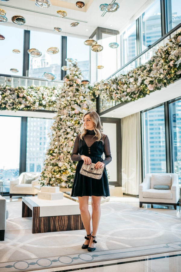 Jessica Sturdy wearing a Free People dress with a sparkle bodysuit, Kate Spade glitter pom pom heels, and a Milly metallic clutch.