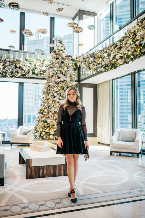 Jessica Sturdy wearing a Free People dress with a sparkle bodysuit, Kate Spade glitter pom pom heels, and a Milly metallic clutch at the Langham in Chicago.