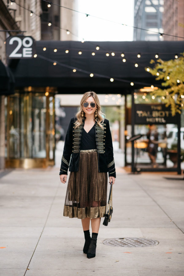 Chicago fashion and lifestyle blogger Jessica Rose Sturdy wearing Ray-Ban aviators, Blank NYC black velvet and gold embroidered band jacket, J.Crew bodysuit, gold midi skirt, black & gold shimmer socks, and Kate Spade black suede pumps with Kenneth Jay Lane gold earrings and a Gucci Marmont black leather bag.