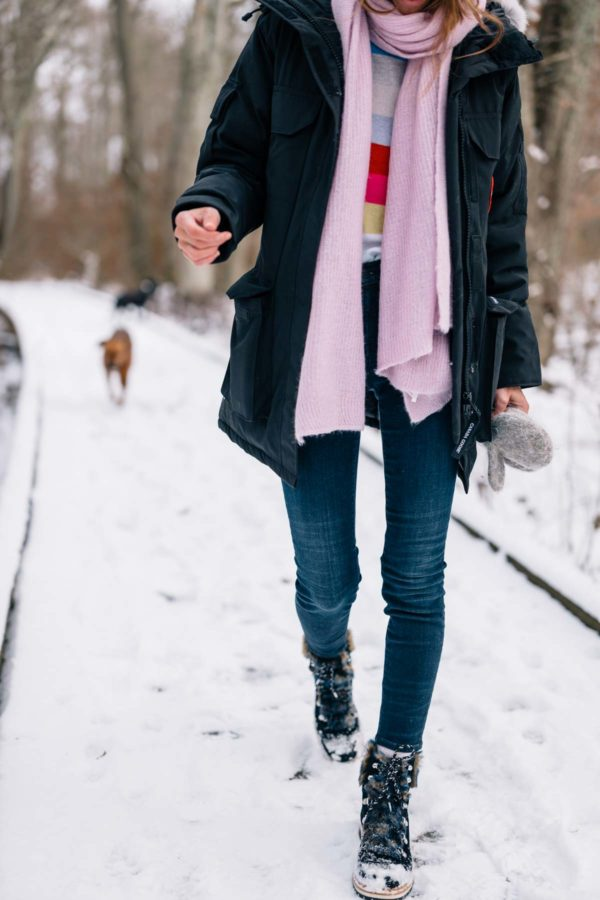 Jess Ann Kirby styling a Canada Goose jacket for snow days