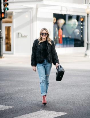 Chicago fashion blogger Jessica Sturdy sharing her winter uniform: black faux fur coat, Old Navy ribbed sweater, Levi's 501 boyfriend jeans, Robert Clergerie pink velvet booties, Polene Paris top handle bag, and Le Specs matte black aviators.