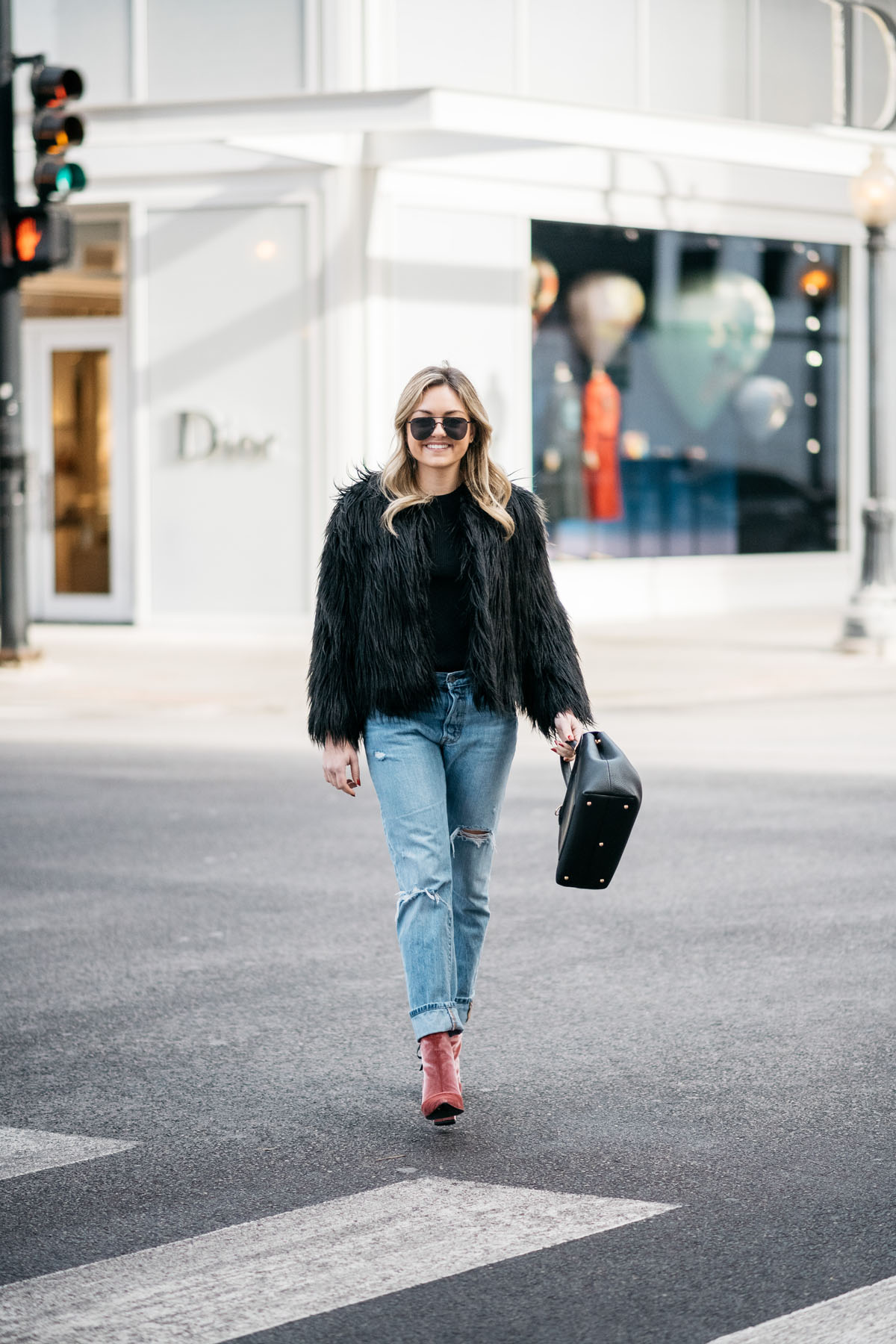 Chicago fashion blogger Jessica Sturdy sharing her winter uniform: black faux fur coat, Old Navy ribbed sweater, Levi's 501 boyfriend jeans, Robert Clergerie pink velvet booties, Polene Paris top handle bag, and Le Specs matte black aviators.