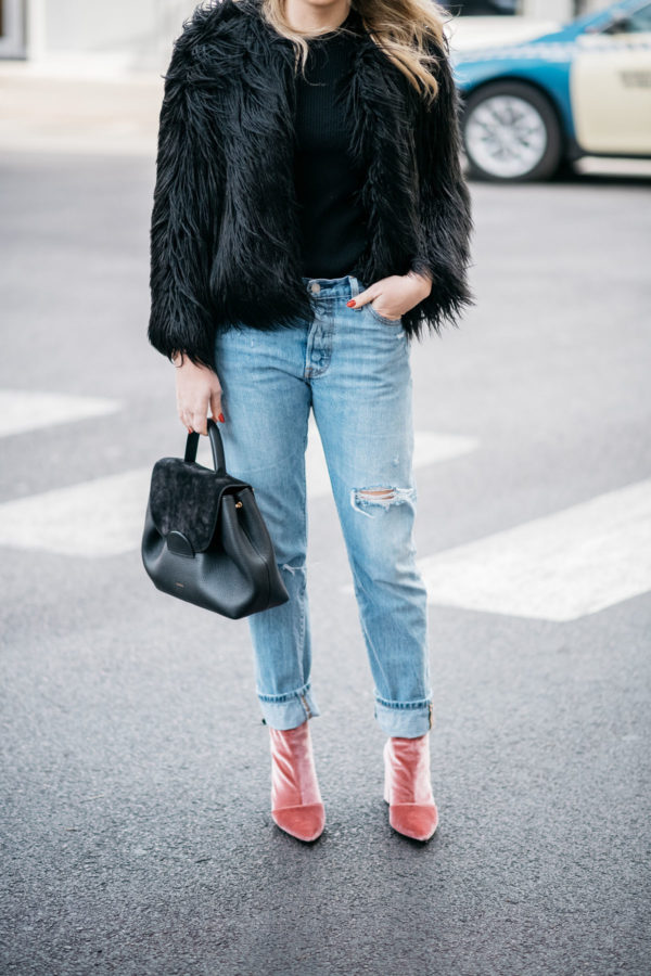 Chicago blogger Jessica Sturdy of Bows & Sequins wearing a 1.State black faux fur coat, Old Navy black ribbed sweater, Levi's 501 boyfriend jeans, and Robert Clergerie pink velvet booties with a Polene Paris top-handle bag.