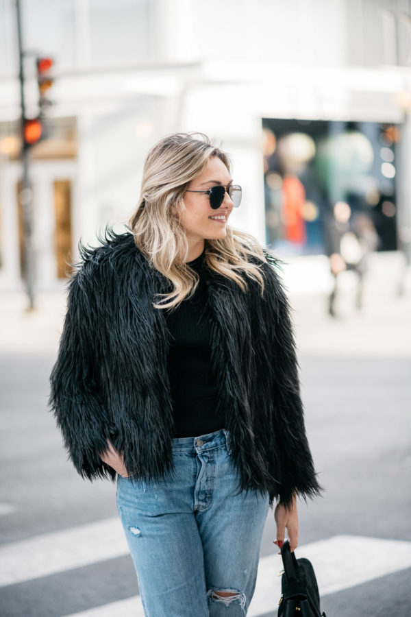 Jessica Sturdy of Bows & Sequins wearing Le Specs aviators, 1.State black faux fur coat, Old Navy ribbed sweater and Levi's 501 boyfriend jeans.