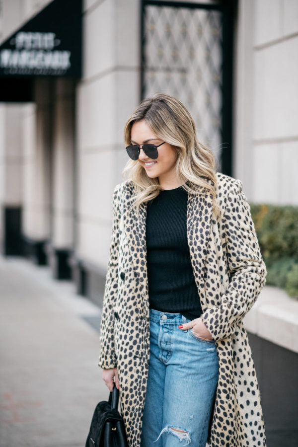 Chicago lifestyle blogger Jessica Sturdy wearing Le Specs aviators, Bows & Sequins leopard coat, Old Navy ribbed sweater, Levi's 501 boyfriend jeans with a Polene Paris top handle bag.