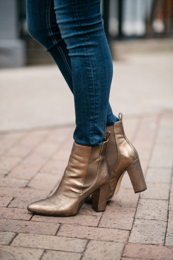 Jessica Rose Sturdy wearing Vince Camuto bronze metallic booties with Rag & Bones skinny jeans.