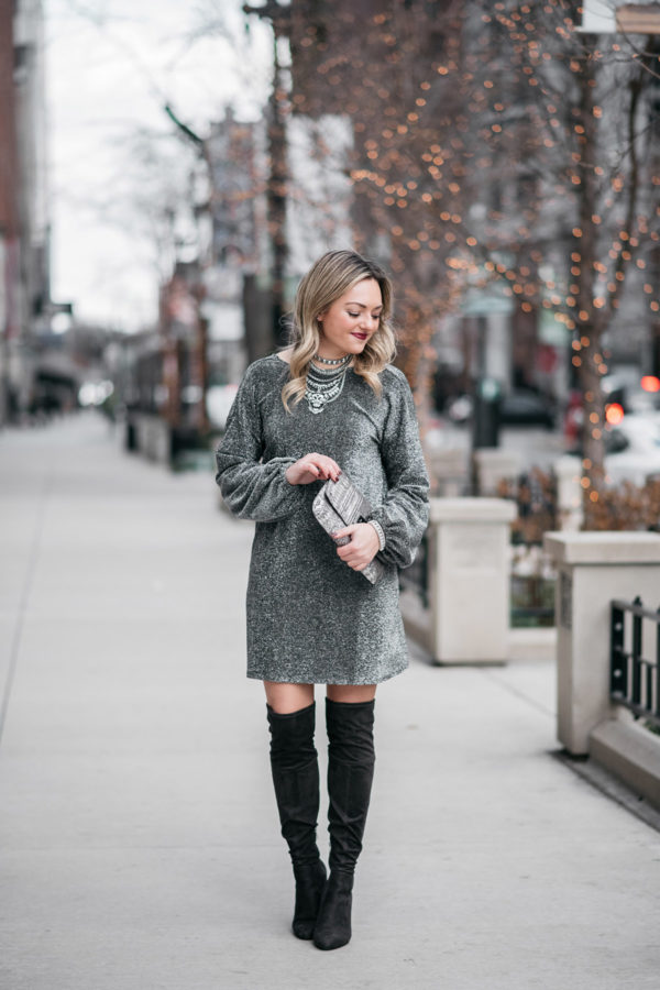 Jessica Sturdy styling a long sleeve silver dress with over the knee boots.