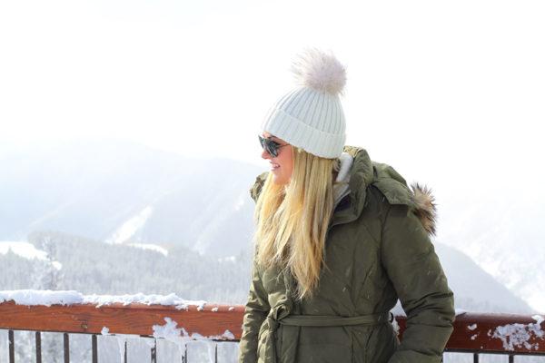 Jessica Sturdy wearing an olive green puffer coat in Aspen.