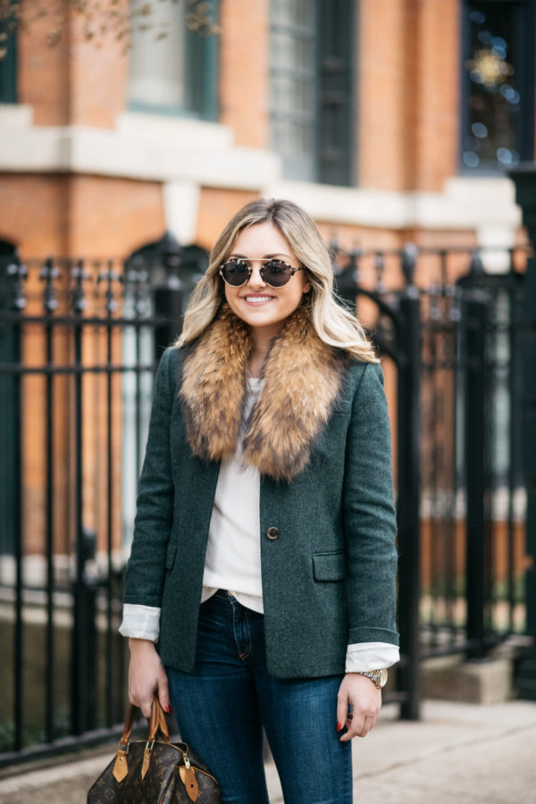 Jessica Rose Sturdy wearing a fur collar from Paris, a green J.Crew blazer, and an Old Navy ribbed tee with Illesteva tortoise sunglasses in Chicago.