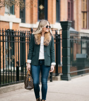 Chicago lifestyle blogger Jessica Sturdy wearing a green J.Crew blazer, an Old Navy ribbed tee, a fur collar from Paris, Rag & Bone skinny jeans, and Vince Camuto bronze booties with a Louis Vuitton monogrammed handbag, Illesteva Milan tortoise sunglasses, and a Michael Kors watch.