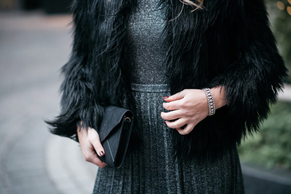 Jessica Sturdy styling a black fur coat and silver dress.
