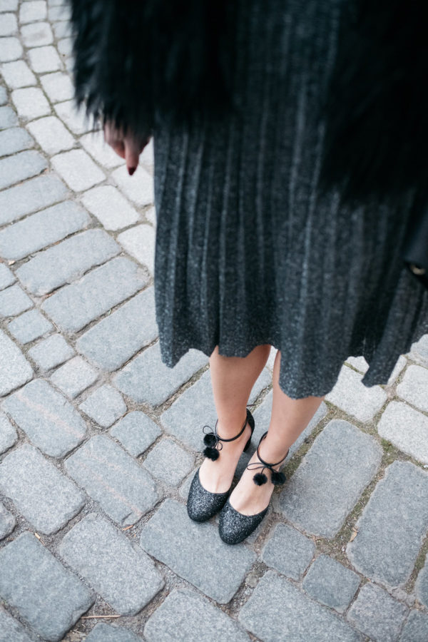 Jessica Sturdy wearing Kate Spade glitter pom-pom ankle strap heels.