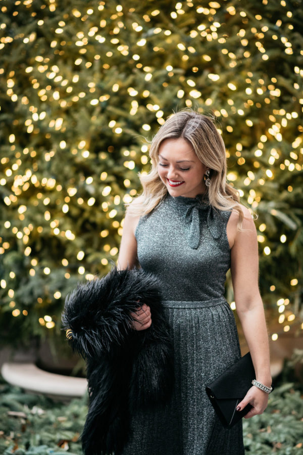 Jessica Sturdy wearing a silver Kate Spade sweater dress.