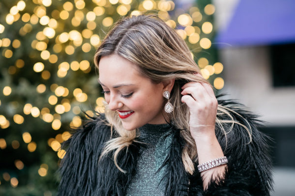 Jessica Sturdy wearing Loren Hope earrings and a black fur coat.