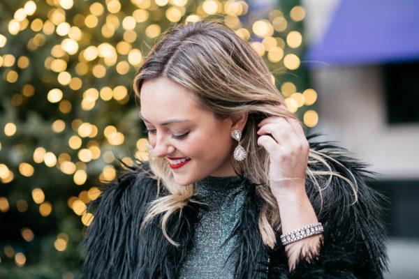 Jessica Sturdy wearing Loren Hope earrings and a black fur coat.