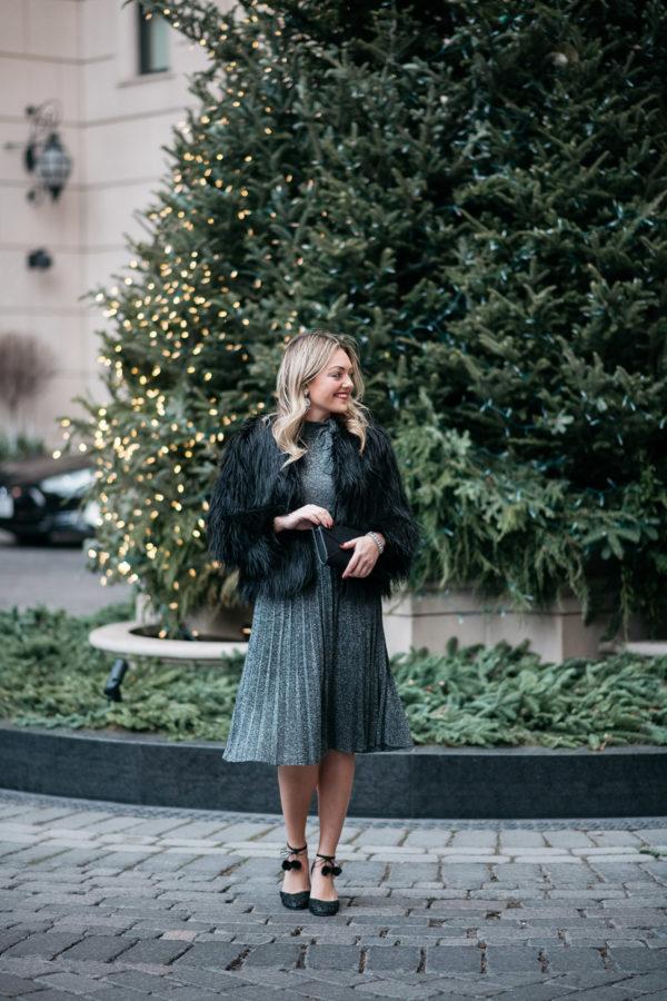 Jessica Sturdy wearing a silver Kate Spade pleated midi dress with a black fur coat.
