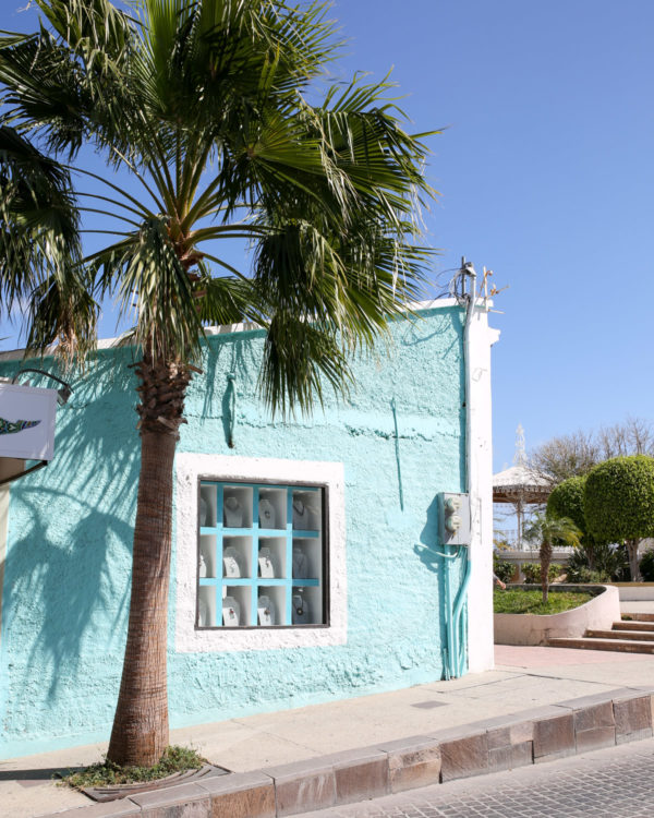 Jessica Sturdy shares photos from exploring San Jose del Cabo in Mexico. Light blue pastel building