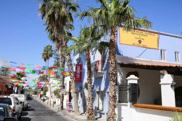 Jessica Sturdy shares photos from exploring San Jose del Cabo in Mexico. Colorful banners between buildings