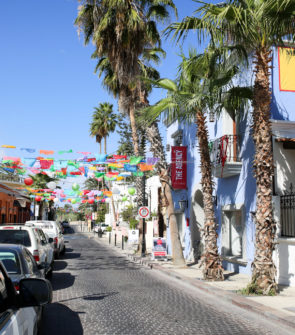 Jessica Sturdy shares photos from exploring San Jose del Cabo in Mexico. Colorful banners in the air