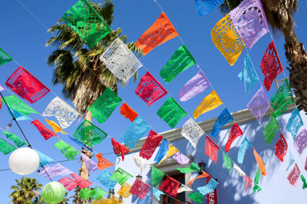 Jessica Sturdy shares photos from exploring San Jose del Cabo in Mexico. Colorful flags in the air