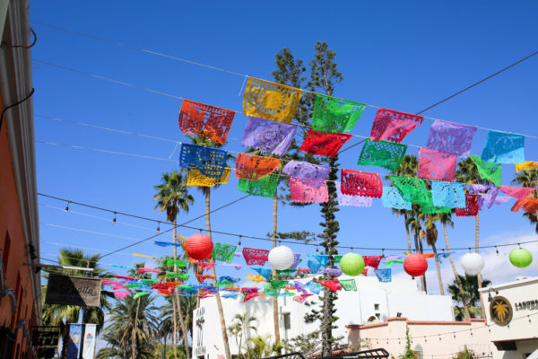 Jessica Sturdy shares photos from exploring San Jose del Cabo in Mexico. Colorful flags and paper lanters