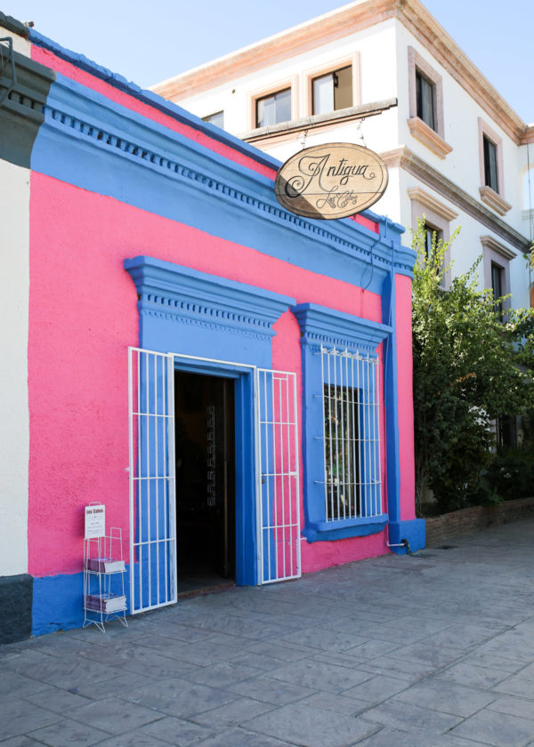 Jessica Sturdy shares photos from exploring San Jose del Cabo in Mexico. Colorful pink and blue buildings