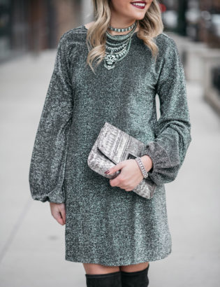 Jessica Sturdy styling a long sleeve silver glittery dress with grey over the knee boots.