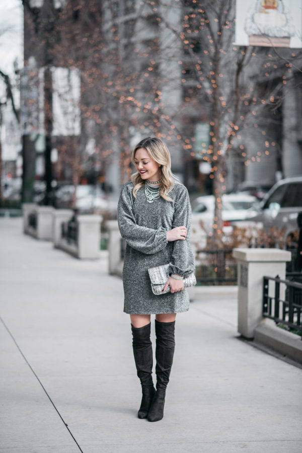 Jessica Sturdy wearing a long sleeve silver dress with over the knee boots.