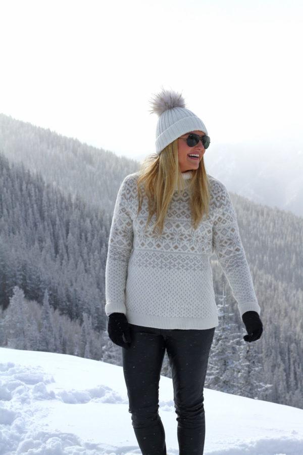Jessica Sturdy on Apsen Mountain in a fairisle sweater and fur pom pom beanie.