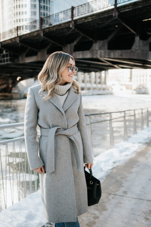 Jessica Sturdy wearing mirrored sunglasses and a Claudie Pierlot grey wool wrap coat in Chicago.
