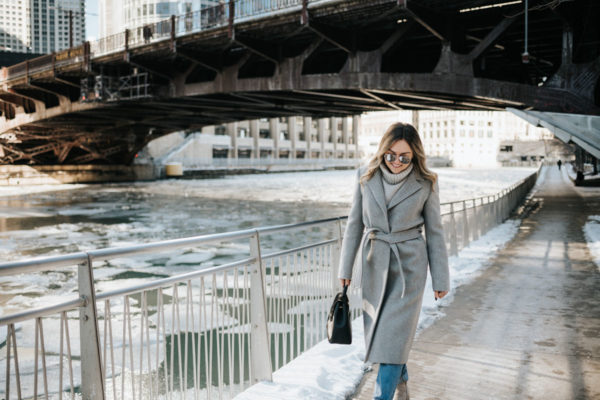 Jessica Rose Sturdy wearing a Claudie Pierlot grey wrap wool coat and a grey turtleneck with mirrored sunglasses and a top-handle Polene bag in Chicago.