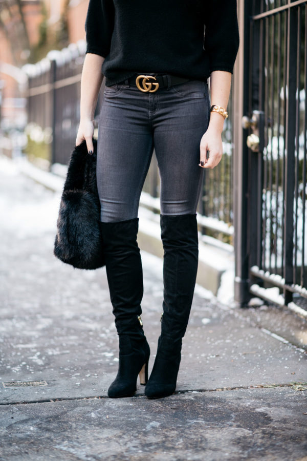 Chicago lifestyle blogger Jessica Rose Sturdy wearing black suede over the knee boots, Rag & Bone skinny jeans, and a gold Gucci GG logo belt with a J.Crew shearling bag.
