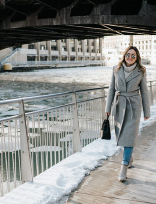 Chicago lifestyle blogger Jessica Rose Sturdy wearing a Claudie Pierlot grey wool coat, Vineyard Vines grey cashmere sweater, Rag & Bone boyfriend jeans, and Linea Paolo grey suede booties with mirrored sunglasses and a Polene Paris satchel.