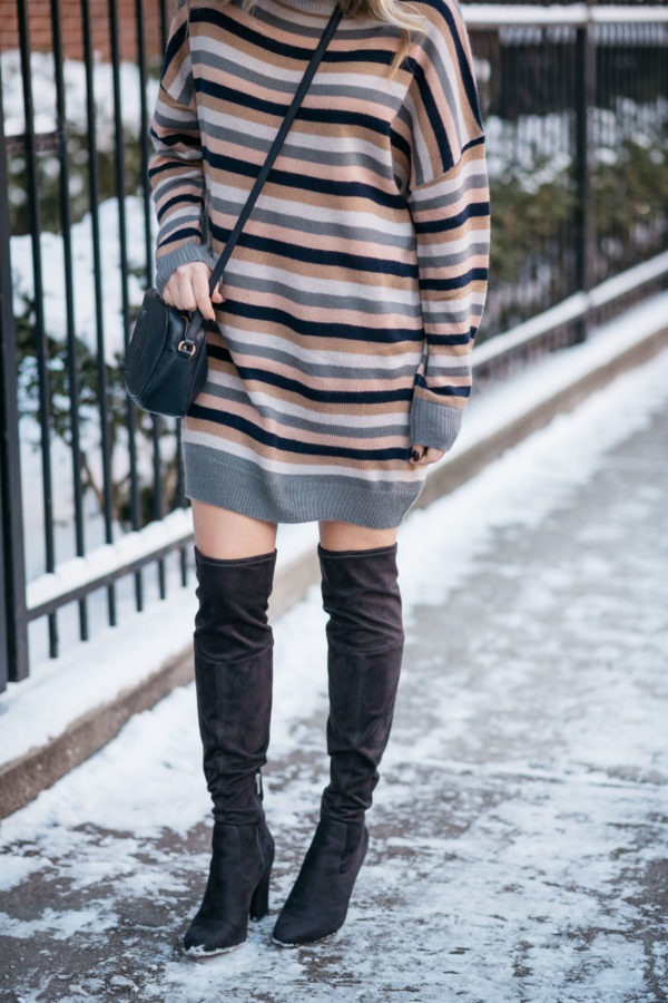 Chicago blogger Jessica Sturdy wearing a Tularosa stripe sweater dress for winter with black over the knee boots and a navy blue Gucci bag.