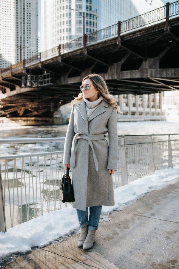Chicago blogger Jessica Rose Sturdy wearing a Claudie Pierlot grey wool coat, Vineyard Vines grey cashmere sweater, Rag & Bone boyfriend jeans, and Linea Paolo grey suede booties with mirrored sunglasses and a Polene Paris satchel.