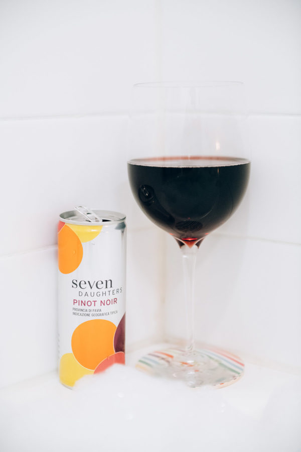A glass of wine in a bubble bath.