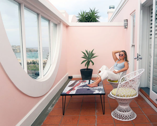 Jessica Sturdy at Hotel Ravesis in Bondi Beach, Australia. A super cute pink hotel with a balcony overlooking the infamous beach.