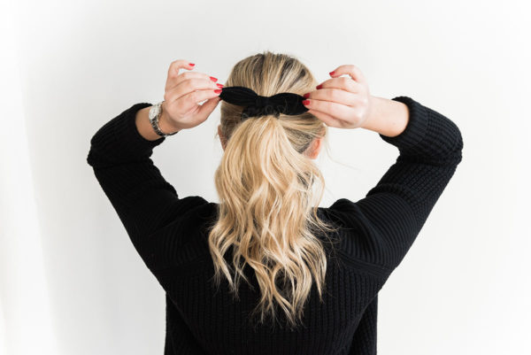 Jessica Sturdy wearing a black bow in her long blonde hair. She is sharing her tips, vitamins, and supplements to grow your hair longer and keep it healthy!