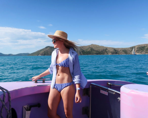 Jessica Sturdy wearing a blue and white J.Crew swimsuit on a boat in the Whitsundays in Australia