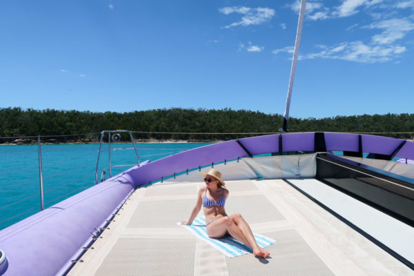 Jessica Sturdy wearing a striped swimsuit on a boat in the Whitsundays in Australia