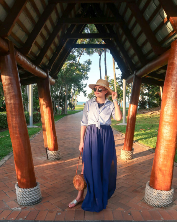 Jessica Sturdy wearing a navy blue maxi skirt and striped shirt tied up in Airlie Beach Australia