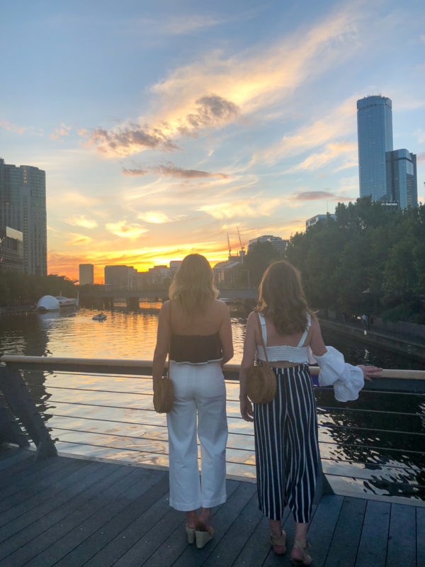 Hallie Wilson and Jessica Sturdy in Melbourne Australia at sunset wearing navy and white stripes.