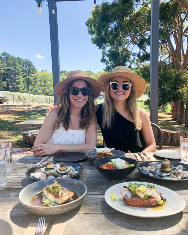 Hallie Wilson and Jessia Sturdy wearing black and white at a vineyard on the Mornington Peninsula in Australia