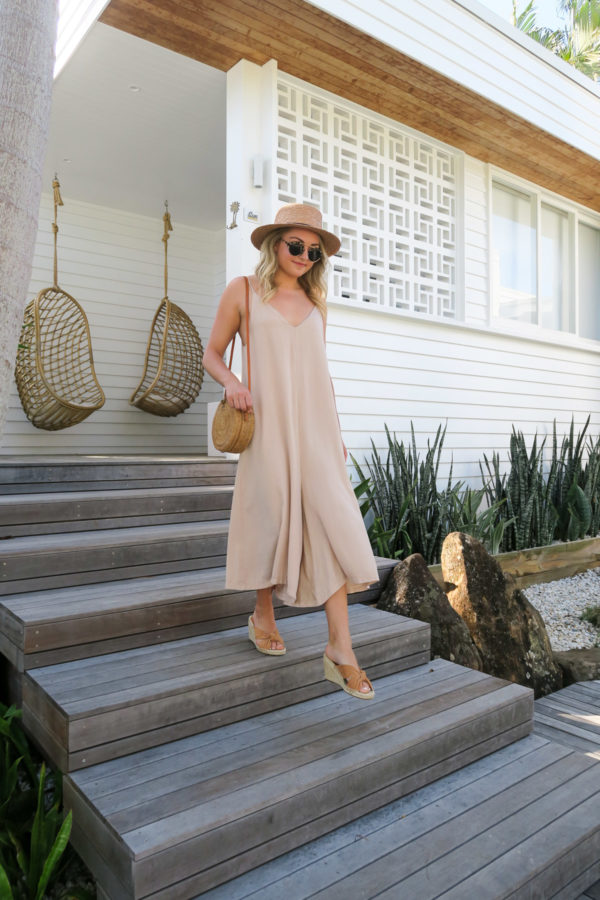 Jessica Sturdy wearing a long jumpsuit and espadrille wedges at Bask & Stow in Byron Bay Australia