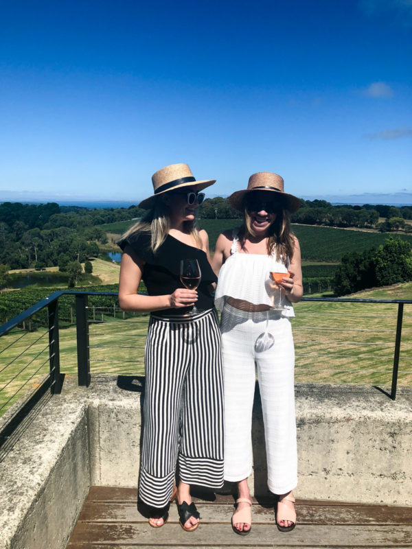Jessica Sturdy and Hallie Wilson wearing black and white outfits at a winery on the Mornington Peninsula outside of Melbourne Australia