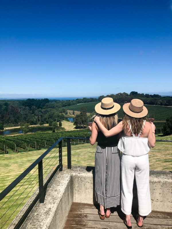 Jessica Sturdy and Hallie Wilson wearing black and white outfits at a winery for wine tasting on the Mornington Peninsula outside of Melbourne Australia