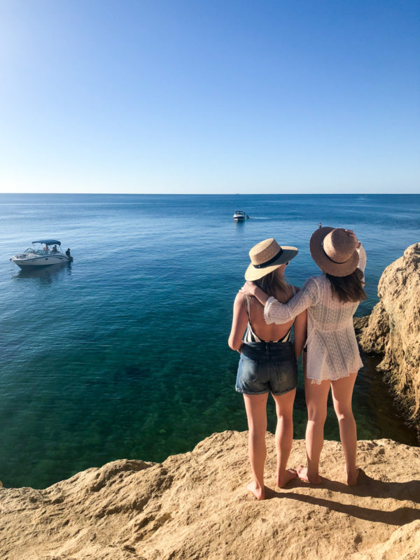 Jessica Sturdy and Hallie Wilson on a rock cliff on the Mornington Peninsula in Australia