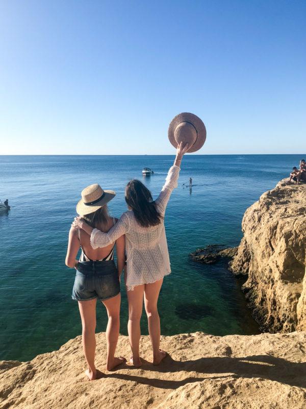 Jessica Sturdy and Hallie Wilson on a rock cliff jumping on Mornington Peninsula in Australia